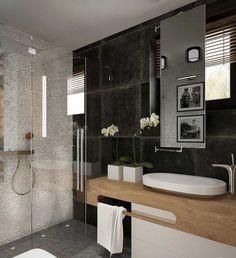 weiße Kieswand, schwarze Wandfliesen und Holz Waschtisch
