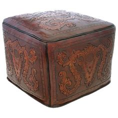 Gorgeous tooled leather ottoman. Not normally into leather furniture, but this is cool.