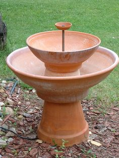 "If you have been looking for a substantial size fountain for your garden, Terra Cotta planters available at your local garden center offer a lot of possibilities and have a pleasing natural outdoor look. The fountain we made for our front garden stands about 32"" tall from the ground to the very top.  The upper bowl is about 21"" in diameter, and the lower basin is approximately 32"" in diameter.  The fountain holds a generous quantity of water."