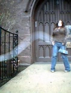 Salem Witch Museum   Alanna sent this ghost picture taken in Salem, Massachusetts in front of the Witch Museum.  It looks like an  orb vapor trail...but what whited-out her face?