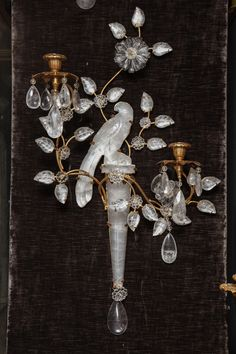 Pr of  Antique French Louis XVI gilt bronze & cut rock crystal sconces by Bagues | From a unique collection of antique and modern wall lights and sconces at http://www.1stdibs.com/furniture/lighting/sconces-wall-lights/