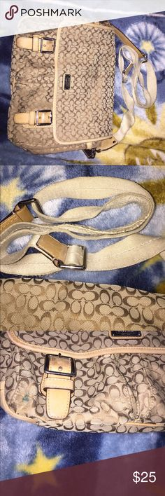 Coach purse Coach purse very used but still works. Lots of wear on back and strap. Lots of pockets for storage Coach Bags Crossbody Bags