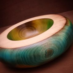 I loved making this bowl. It's about 9 inches across and the finish is silky smooth. Scorched with a blow-torch and stained with spirit based stains and carefully blended together, this bowl looks and feels amazing.