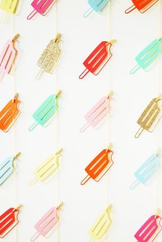 Popsicle Party: Throw the ultimate poolside party with a Popsicle theme to keep guests cool while having fun in the sun. Have guests partake in a yummy Popsicle DIY or relax on Popsicle shaped pool floats. Whichever ideas you carry out for your icy treat of a party, don't forget to throw in these adorable Popsicle garlands. (via You Are My Fave)