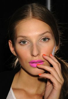 Stunning simple skin and brows, with a vibrant, bright pink lip. // Backstage at Millys.