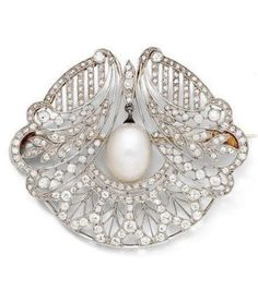 An Edwardian pearl and diamond brooch, circa 1910. Of openwork floral design, millegrain-set throughout with rose and old brilliant-cut diamonds, suspending a 14.1mm x 11.2mm pearl drop to the centre, composite, length 4.9cm. #Edwardian #brooch