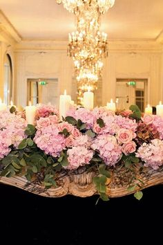 White candles, hydrangeas and Pink Roses