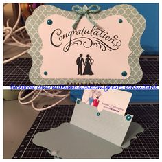 Gift card holder.  Cut from the CTMH Artiste Cricut cartridge.  Used CTMH Whimsy Paper Fundamentals Glacier cardstock for the holder and CTMH White Daisy for the sentiment.  For the sentiment shape, I sliced a piece off of the gift card holder shape in Cricut Design Space.  Used the CTMH Happy Couple stamp set and stamped in CTMH Black ink.  Embellished with CTMH Glacier twine and with glitter enamel dots from virginiaturtle.com.