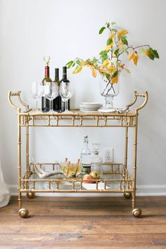 Bring in fresh flowers and fruit when styling your bar cart as seen on Bazaar