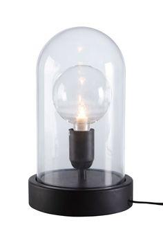 Bordslampa av polyresin och klarglas. Svart sladd med strömbrytare, sladdlängd 1,8 m. Mått: 33x18x18 cm. E27. Max 60W. Ljuskälla ingår ej. Olika typer av glödlampor förändrar stilen hos din lampa. Prova dig gärna fram till ditt eget uttryck! <br><br>