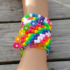 These kandi bracelets are made with rainbow pony beads and perler flowers. Kandi Patterns, Beading Patterns, Stitch Patterns, Rave Bracelets, Beaded Bracelets, Kandi Cuff, Kandi Mask, Rave Gear, Scene Kids