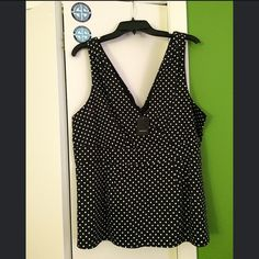 NWT! Sleeveless Polka Dot Blouse Brand new with tags. Sleeveless polka dot blouse from Torrid. Looks great under a blazer or sweater! torrid Tops Blouses