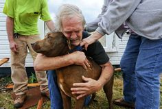 Greg Cook hugs his dog Coco after finding her inside his destroyed home in Alabama following the Tornado in March, 2012.  Image by The Decatur Daily, Gary Cosby Jr / AP