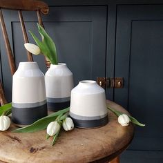 Charcoal vases and tulips. I'm planning to do a little giveaway very soon so if you fancy winning a piece of pottery or two watch this space...