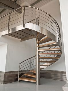 steel wood spiral staircase hot sale,wood spiral stairs,wood spiral stairs kit is made from steel central column and wood treads Wooden Staircase Design, Spiral Stairs Design, Steel Railing Design, Wooden Staircases, Spiral Staircases, Staircase Makeover, Staircase Railings, Industrial House, Industrial Interiors