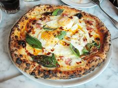 More people should be talking about Motorino's brunch pizza. Of course, the crust is fantastic, leopard-spotted, puffed and chewy, but the combination of bubbling mozzarella, chili oil, fresh basil, smoky pancetta, and oozing baked eggs make this pie a breakfast masterpiece.