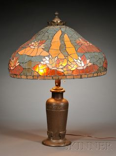 Handel lamp with quezal shade verdigris metal and art glass early handel lamp base and a mosaic glass shade patinated metal and mosaic glass united states mozeypictures Choice Image
