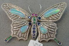 WHITE GOLD BUTTERFLY BROOCH WITH 4 OPALS, DIAMONDS, EMERALDS, RUBIES, SAPPHIRES