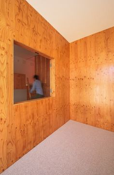 House in Asahiku by Coo Planning The architect used Japanese larch plywood to cover walls and ceilings throughout the property. The same material was used to build bespoke furniture, while the oiled wood floors offer a matching tone.