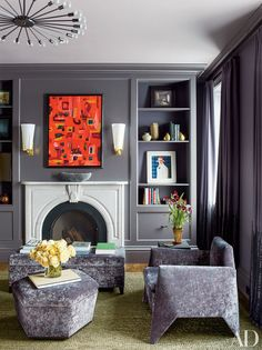 An artwork by one of the homeowners adds a burst of color above the master bedroom's fireplace, while a Matthew Barney photograph is displayed on a bookshelf; the armchairs (one is shown) and small ottoman are vintage designs by Lloyd Wright. Design Salon, Hall Design, Best Interior Design, Interior And Exterior, Interior Paint, New York Townhouse, Architectural Digest, Interiores Design, Decoration