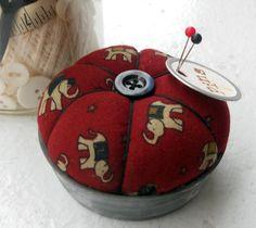 pin cushion made from an old mason jar lid.