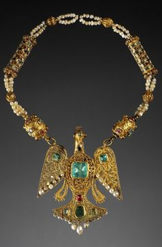 Bird pendant, Morocco, 18th century, This pendant shaped a peacock with outspread wings and tail fan-shaped, whose symbolize happiness and marital happiness. emeralds, amethysts, ruby, pearls, enamel, gold, 40 x 8.2 x 2.9 cm, 127 g