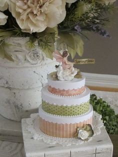 """It is a mini """"cake"""" she made with the Once Upon a Springtime Collection and a set of mini oval boxes from Melissa Frances. This would be a sweet treat for a birthday party favour or a centerpiece for a party table."""