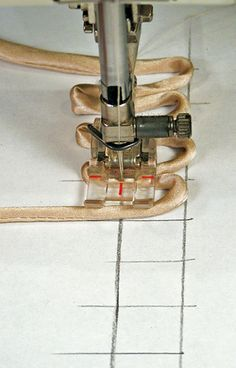 Sewing Loop Button Holes..paper guide;