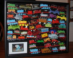 Shadow Box Memories -- An awesome way to display all of Tillman's favorite Thomas and Friends wooden trains! Love the idea of putting a pic of child playing with them too! Shadow Box Memory, Train Room, Thomas The Train, Thomas And Friends, Gifts For Boys, Boy Room, Kids Playing, Decoration, Memories