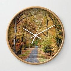 Fall wall art is a great way to elevate the look of your home. Whether it be colorful fall leaves, cute orange pumpkins or beautiful cornucopias. You can effortlessly make your home fall worthy by using several pieces of #autumn wall décor throughout your home. Do this with fall wall art, fall wall wreathes, fall wall clocks and even fall canvas art to create a warm and inviting #fall paradise.   Society6 Autumn Passage 2 - Fall Landscape Scene Wall Clock Natural Frame, White Hands