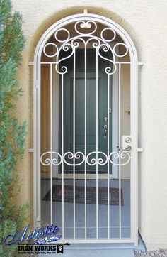 Arched wrought iron entryway powder coated white