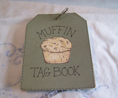 MUFFIN TAG BOOK...Cut tags out of cardstock; stamp little things pertaining to muffins, color, cut out; type muffin recipes on computer and cut; adhere all the stuff; punch hole and put ring through top; see other tags for ideas.  Nice gift to give someone who loves muffins.