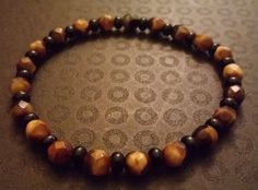 Amber glass swirl and black beaded bracelet by BritkneesBootique on Etsy