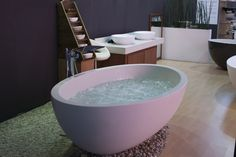 Castello freestanding bath with hydrotherapy air spa system.