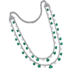 Emerald and diamond necklace. The front designed as a double chain of circular-, fancy-cut and baguette diamonds supporting a fringe of drop-shaped emeralds and briolette diamonds.