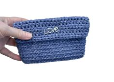 "Crochet purse blue. Knitted purse denim. Handmade purse. Pocketbook denim. Card holder crochet. Handmade wallet. Card wallet. Everyday purse by Baby clothes and Gifts Crocheted handmade with very light T-shirt yarn.Closes with a magnetic clasp, closes perfectly with a ""click"". He carry a bead with the word ""love""Color: Blue jeans.Approximate Measures: 5,90 in (15 cm) long, 4,33 in (11 cm) wide.It is ideal for you, as well as a nice and cheap gift, to any woman around you. It will be a very…"