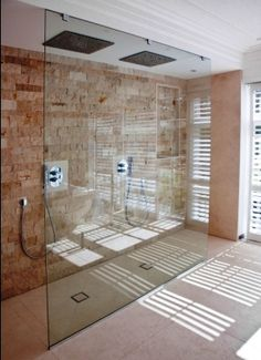 wall of glass shower room - Alison's favourite because the glass is floor to ceiling