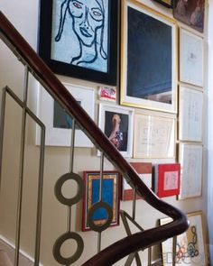 Artworks by Donald Baechler, Anish Kapoor, and Jean-Michel Basquiat on the second-floor landing; the galvanized-metal stair railing was designed by Tom Dixon.