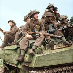 British infantry ride on Sherman tanks in Holland, 24 September 1944, pin by Paolo Marzioli