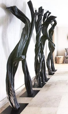   FOYER   Haunting, sculptural trees fill this foyer in Luxury chalet No.14, Verbier, Switzerland. Designed by Fiona Barratt Interiors.
