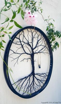 Re-purpose a bicycle wheel and make a tree of life. Full tutorial on the blog
