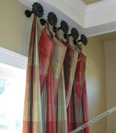 Love this. Curtains tied to holdbacks mounted nearly to the ceiling.