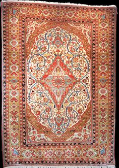An exceptional antique Mohtashem Keshan rug with a remarkable palette including a yellow border. Central Persia, circa 1890.