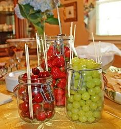fruit display...different fruits in mason jars decorated, with sticks to collect them on :)