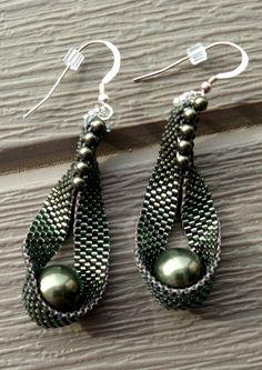 "Pea in a pod: Swarovski pearls, 2.5"" long. 925 ear wires"