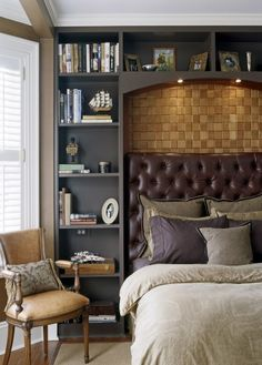 bookcases flanking bed with shelves across top of bed for lighting