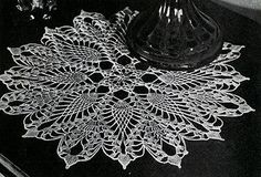 Doily crochet pattern originally published in Pineapple Designs, Spool Cotton Co #230.