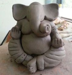 Image result for earth clay ganesha idol
