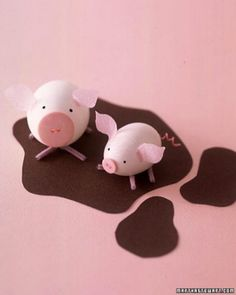 Egg Pigs: This mama and her round little egg piglet relax in brown construction-paper mud.