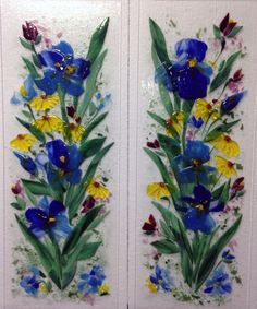 """We created these two fused glass cabinet panels for our client in Michigan. Each panel is 11"""" x 32"""". The motif is floral featuring colorful blue irises and yellow daisies."""